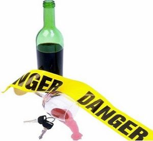 Cariati Law Toronto, Ontario Injury Lawyers Drunk Driving Wine Glass with Car Keys and Caution Tape