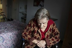 Cariati Law Toronto, Ontario Injury Lawyers Nursing Home Abuse Elderly Woman looking sad in dark room alone
