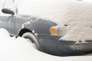 Cariati Law Toronto, Ontario Injury Lawyers Auto Accidents Car Covered in Snow