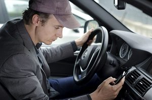 Cariati Law Toronto, Ontario Injury Lawyers Distracted Driving Lawyers Serious Injury Man Driving with cellphone