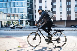 Biker crossing street