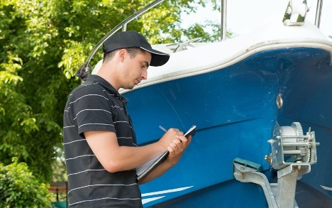 Man performing a full boat inspection in Ontario Canada